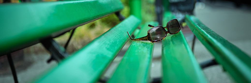 Sunglasses On Green Bench
